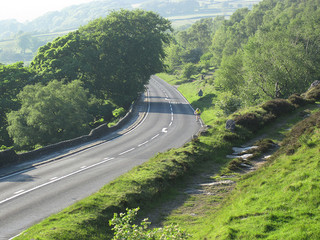 Cyclist heading up beneath Millstone Edge. Seen from Surprise View